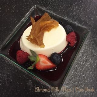 A creamy almond milk flan with sweet berry water and additional berries to complete the look.
