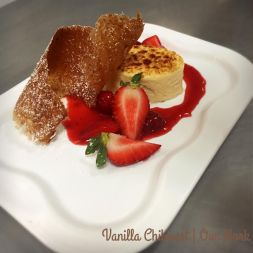 Vanilla chiboust, fresh berries, and a honey wheat tuile.